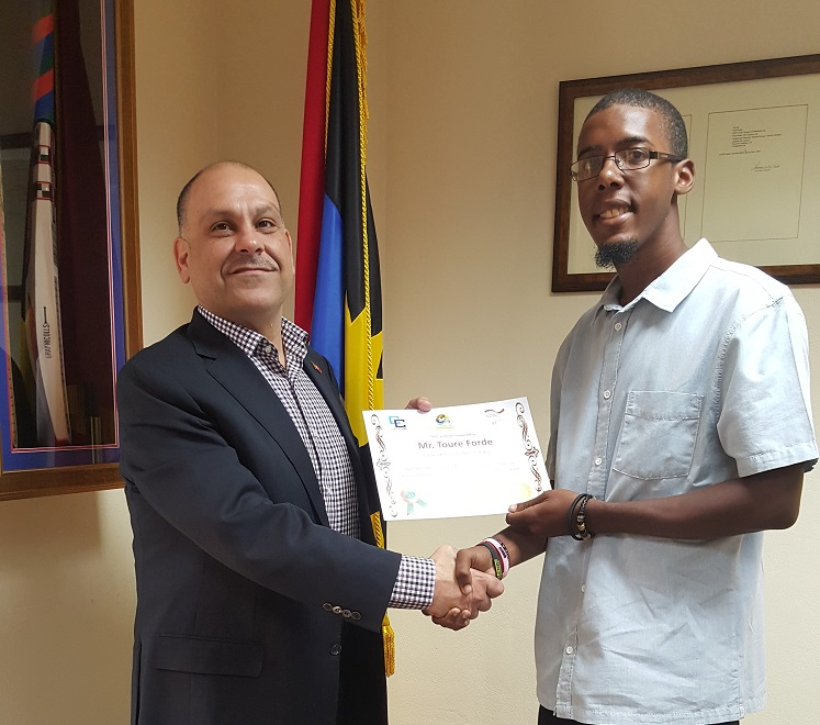 Minister of Energy the Hon. Asot Michael awards Toure Forde 1